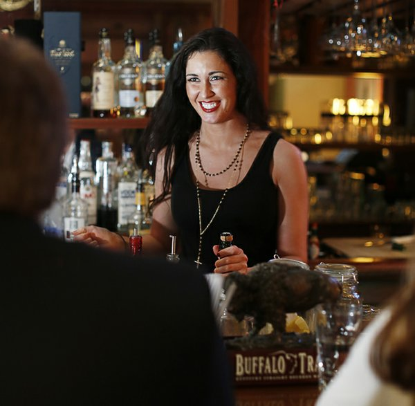 Mallory Burnett creates hand-crafted cocktails at Twelve Bar.