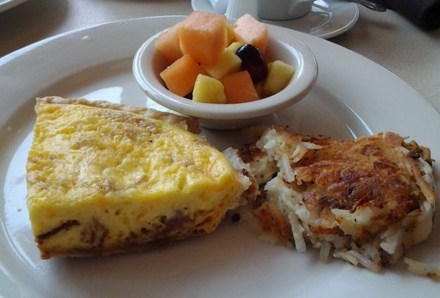 Bacon and cheese quiche, fresh fruit, and Paula Deen's mashed potato casserole make a hearty breakfast at The Booksellers Bistro.