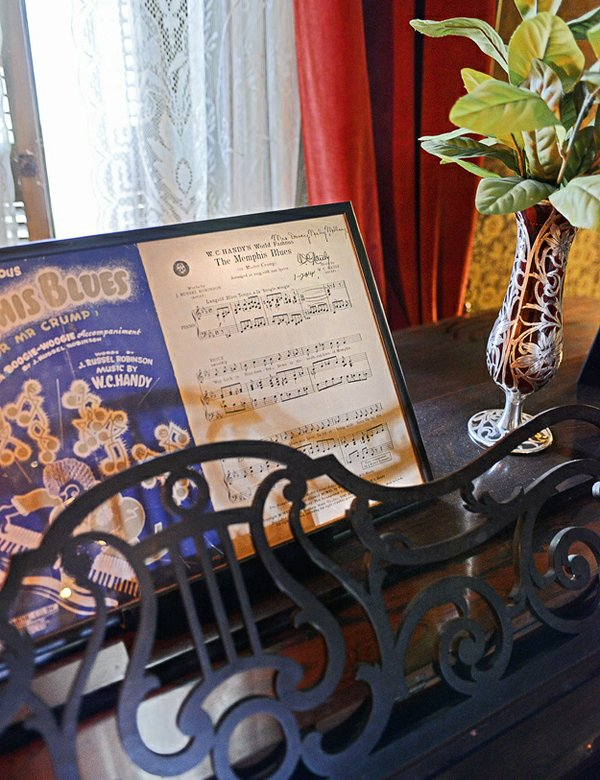 "W.C. Handy performed in the house and sheet music of ""The Memphis Blues"" signed by him sits atop the piano in pride of place."