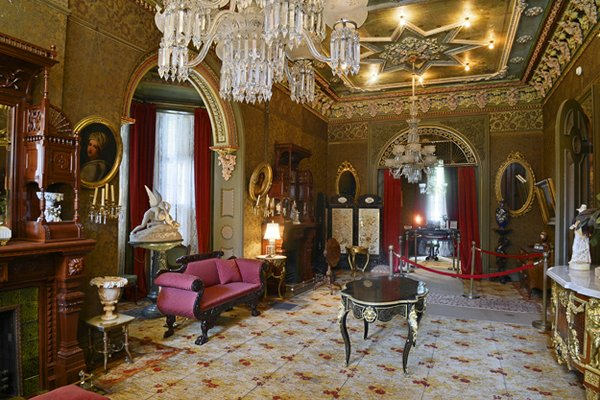 The first floor's double parlor is the showstopper of the house with two fireplaces featuring elaborately carved overmantels, a four-panel Chinese silk and teak screen depicting the four seasons, and a marble replica of Antonio Canova's Psyche Revive...