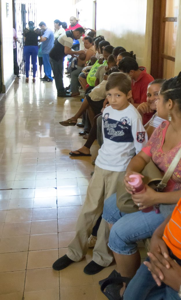 Parents line up with children seeking help for ailing hearts.