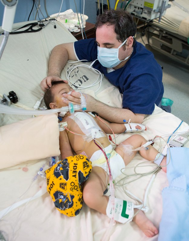 Respiratory therapist David Purvin provides oxygen to a patient.