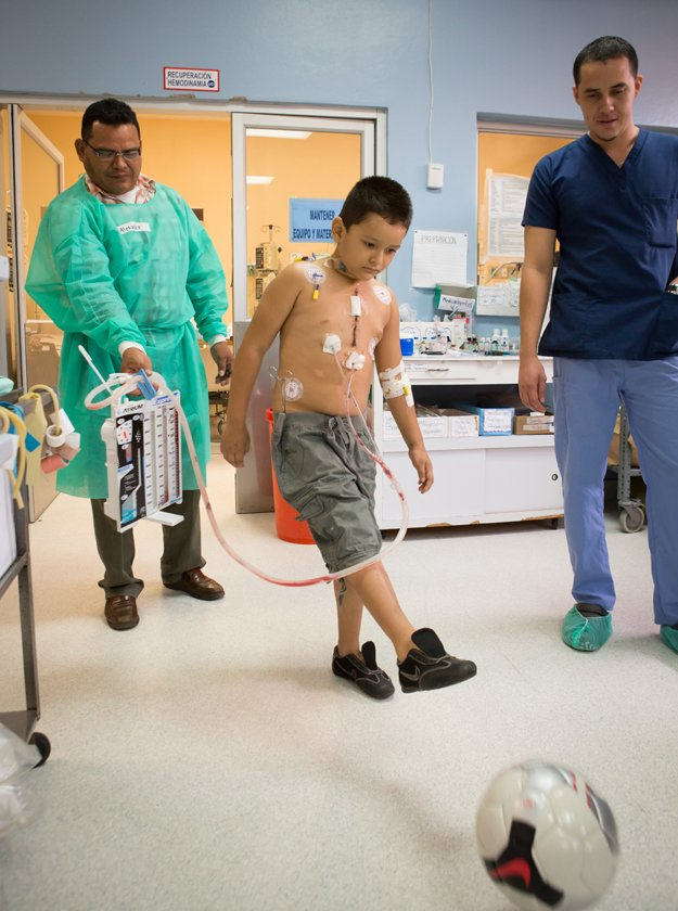 Only one day after surgery, patient Isander David  finds strength to kick a soccer ball.