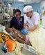 Dr. Glenda Lopez and Dr. Tom Higgins tend to Juan Manuel in pediatric ICU.