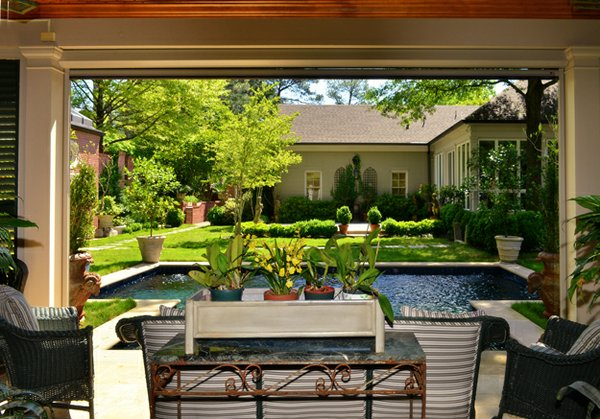 This wide-angled view from the pool house looks across the garden towards the main house.