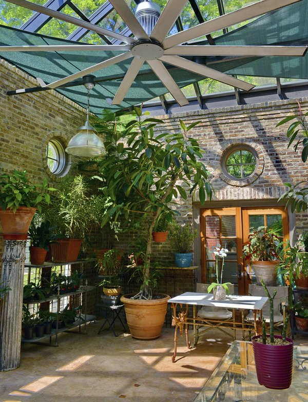 The inviting greenhouse is filled with oceans of orchids and other plants and provides a botanical entryway through the double doors into the guesthouse.