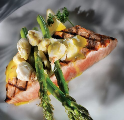 A choice dish at Sharky's: Cooper River salmon topped with fresh jumbo lump crabmeat and grilled asparagus in hollandaise sauce.