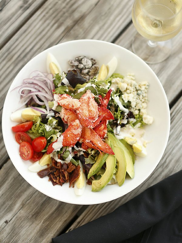Customers may remember John Bragg's popular lobster cobb salad now offered at Sharky's. Sweet and juicy lobster meat, bacon, egg, avocado, blue cheese, and tomato adorn a mound of mixed greens.