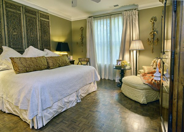 The spacious downstairs master bedroom is both tailored and inviting.