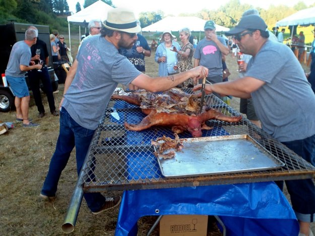 Chefs Andy Ticer and Michael Hudman go Hog Wild in Oregon; so does chef Felicia Willett, below, touring Elk Cove Winery, where the pig roast was held Saturday.