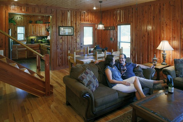 Paul and Jennifer Chandler, relaxing in their cabin.