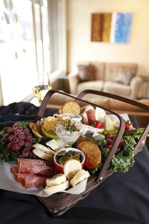 A picnic basket for two is one delicious option at Greencork, a self-serve wine bar operated by Robin Brown and her daughter, Katy Sloan, pictured above.