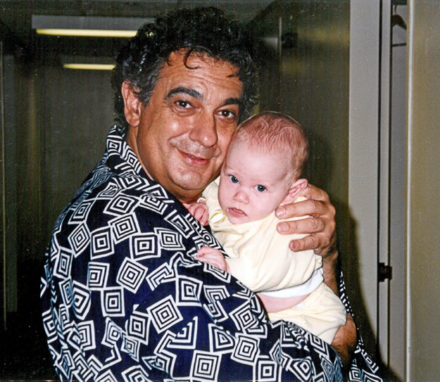 Her good friend and colleague Placido Domingo cradles Esperian's infant son John, 1993.