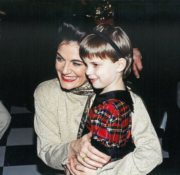 """The singer meets a young patient after a benefit show for St. Jude Children's Research Hospital in 1998 — a performance she describes as """"one of my most beautiful memories."""""""