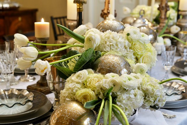 Close-up of one of the dining room table's magnificent, creamy white floral displays.