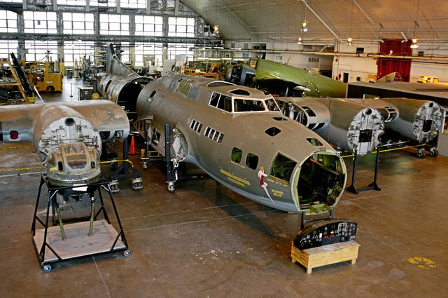 Minus its four mighty engines, the Belle gets special attention in the museum's restoration hangar.