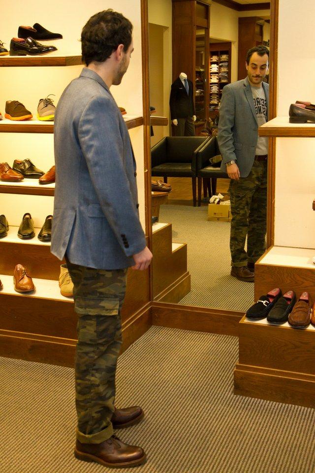 A stylish shopper checks out the Trask shoe.