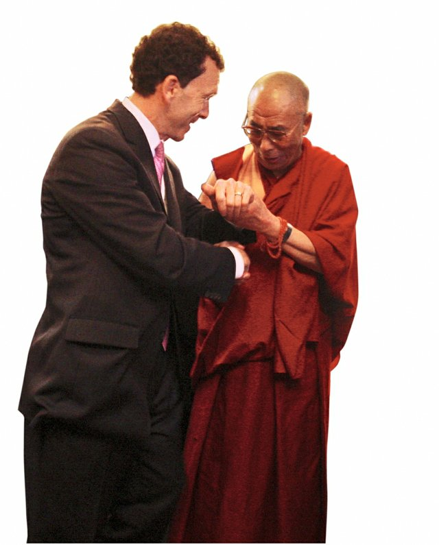In 2009 Greenstein greets the Dalai Lama , recipient of the National Civil Rights Museum's Freedom Award.