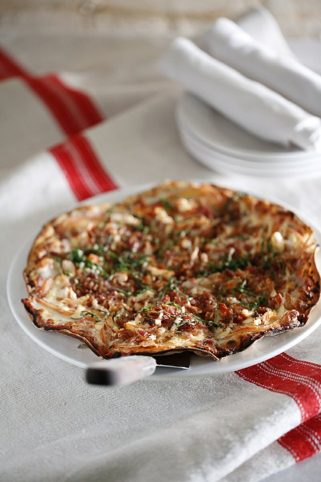 Ronnie Grisanti serves longtime favorites from family recipes at his Collierville restaurant located in the Sheffield Mall. His popular lobster pizza includes smoked applewood bacon, chipotle aioli, spinach, and mozzarella.