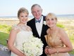 The bride with her proud parents George and Julie Ellis.