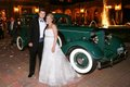 The bride and groom prepare to depart the fabulous reception in a Packard Super Eight.