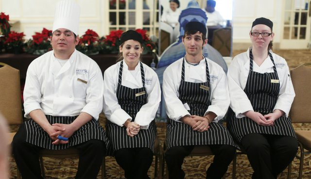 Members of Team Salmon nervously await the judges' decision.