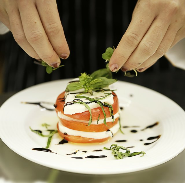 A chiffonade of basil is the finishing touch on the team's Caprese Tower Salad.