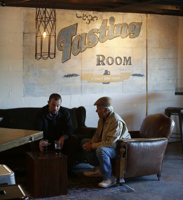 The Tasting Room inside The Growler Shop gives customers a place to sip and taste the beer before taking the suds home with them.