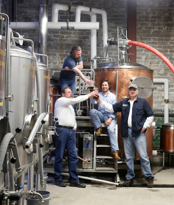 Mike Lee, Brice Timmons, Ross Avery, and Ryan Staggs raise a glass inside High Cotton.