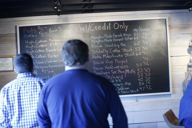 The beer board at The Madison Growler Shop, which offers many local beers, lists the beer's price and its gravity, or alcohol by volume.