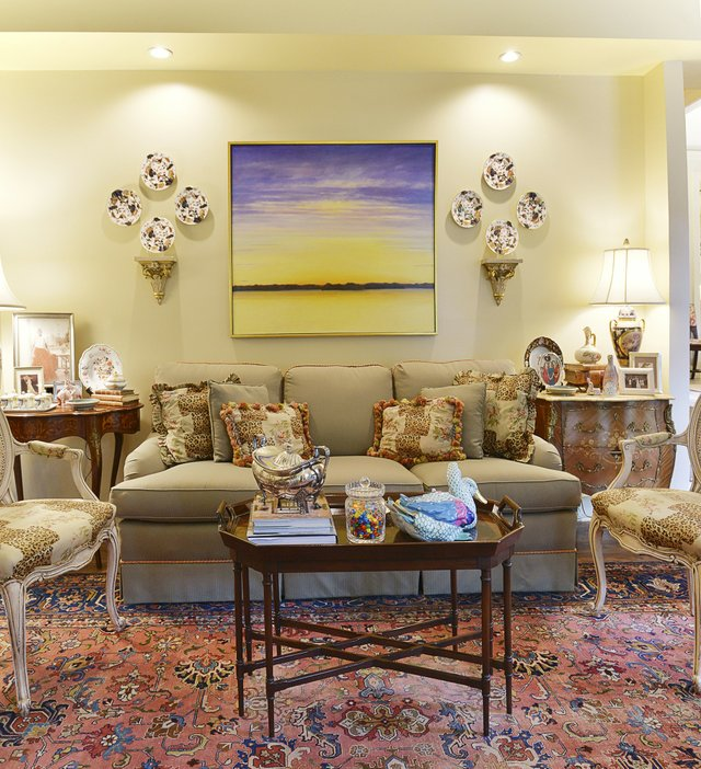 Another view of the living room with its mix of antique porcelain and a modern Mississippi River scene by Memphis artist Martha Scott.