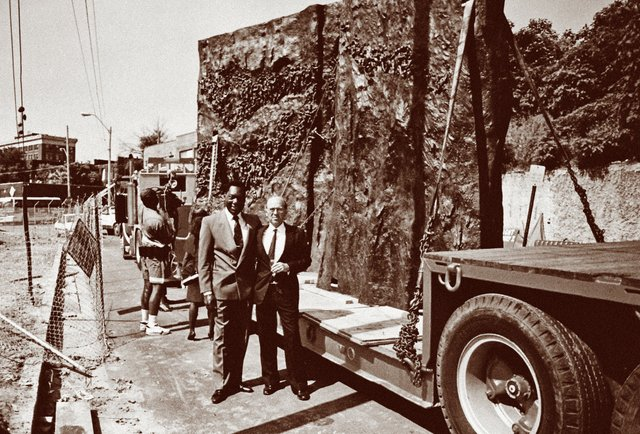 """In 1991, D'Army Bailey and J.R. """"Pitt"""" Hyde were on hand for the delivery of the museum's signature sculpture, Movement to Overcome."""