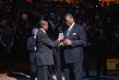 Bernard King receiving award from Meka Eqwuekwe.
