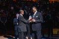 Bernard King receiving award from Meka Eqwuekwe.