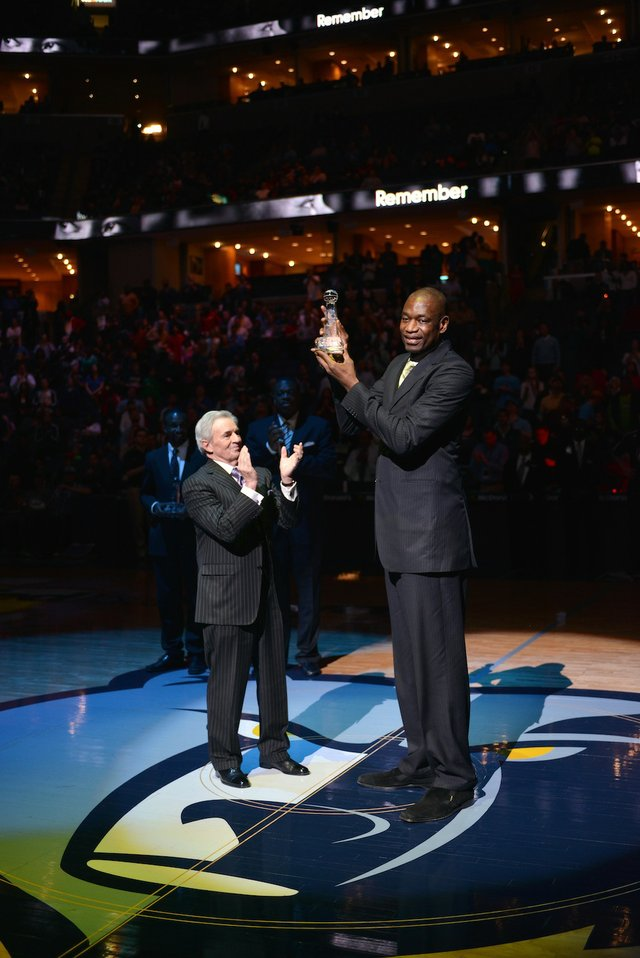 Dikembe Mutombo receiving award from Dan Mullaly.