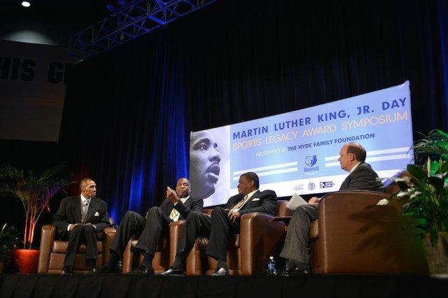 JoJo White, Dikembe Mutombo, and Bernard King with moderator Pete Pranica at the symposium.