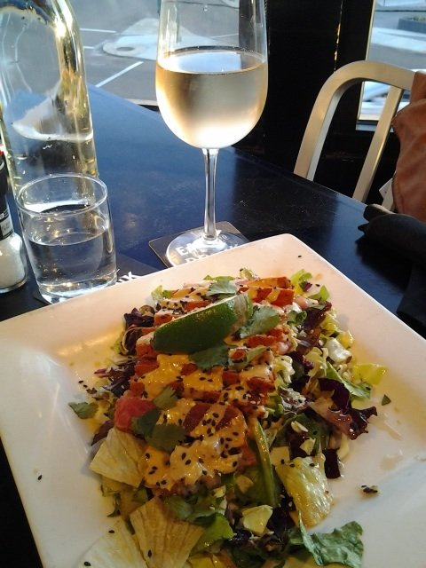 An Elk Cove pinot gris is a nice match for Local's view of Overton Square and a pretty salad sprinkled with sesame seeds.