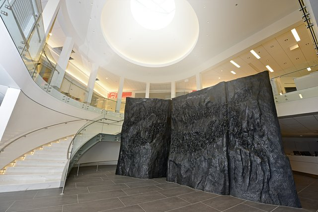 The new entry to the museum features a sweeping staircase and the stunning sculpture by Michael Pavlovski, Movement to Overcome.