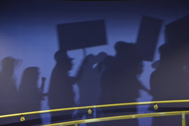 A line of marchers reminds visitors that the movement continues.