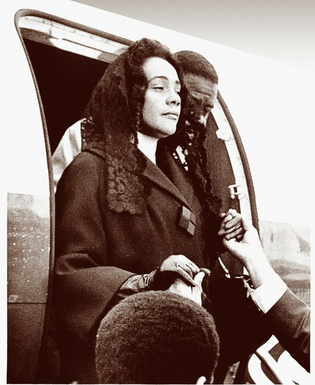 Stunned but poised, a grieving Coretta Scott King arrives at the Memphis airport to escort her husband's body home.