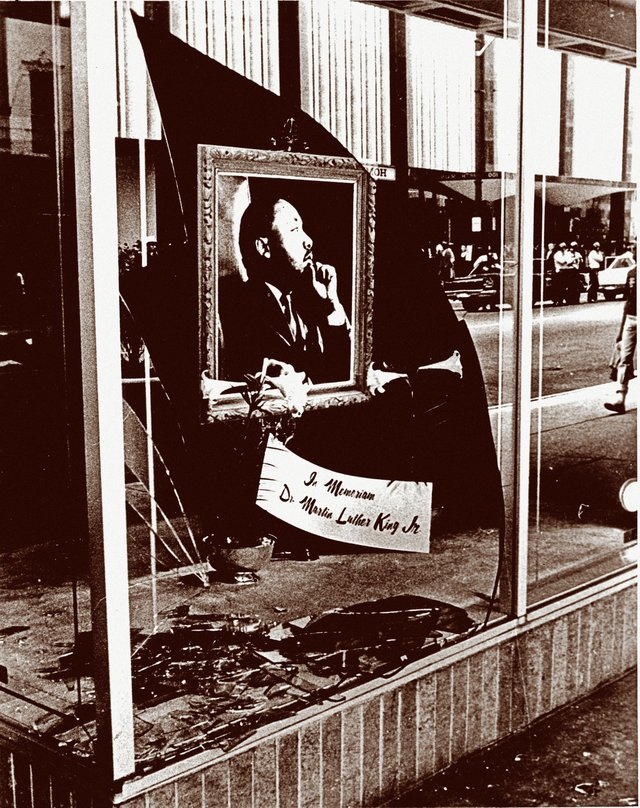 A storefront window on North Main Street, shattered by the riots and demonstrations that followed King's death, was transformed into a makeshift memorial to the civil rights leader.