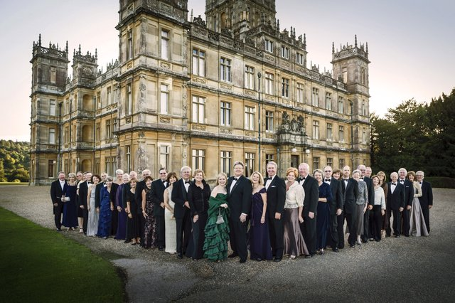 Upon arrival at Highclere Castle, ancestral home of the Carnarvon family, the regally attired Memphis guests fanned out in a V-formation pose.