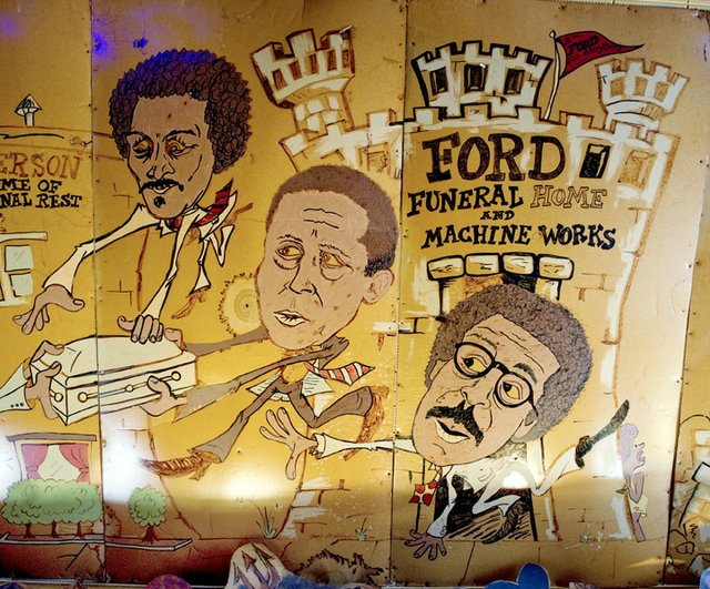 Dating from the 1980s, cartoonist Brad McMillan's famous murals on the walls of the P&H Cafe in Midtown include a Ford family section featuring brothers (left to right) James, Harold Sr., and John. | photograph by Brandon Dill