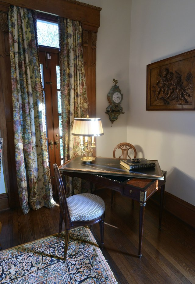 An antique French tric-trac table, created for a game similar to backgammon, is the focal point of this corner of the living room.