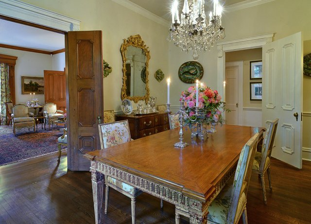 "The dining room is chock full of ""important"" pieces, including the collection of palissy ware on the walls and the nineteenth-century silvered-bronze and crystal chandelier based on a Versailles model. The table and chairs were custom-made by Nancy Cor..."