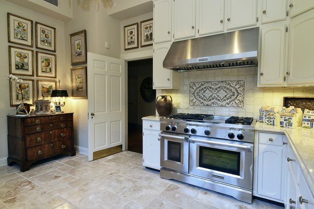 The kitchen was completely redone with limestone floors, marble countertops, and a chef's stainless-steel stove for Mary Helen, an accomplished cook.
