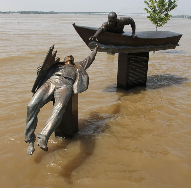 The new monument in Tom Lee Park captures the drama of the 1925 rescue. Though it's normally on dry land, the major 2011 spring flood gave the sculpture special poignancy.
