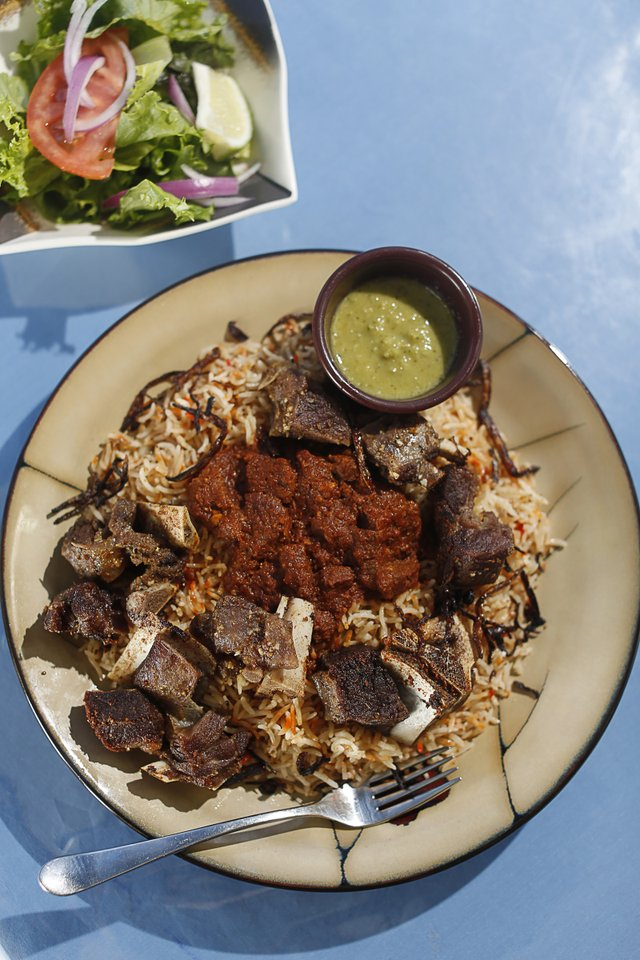 Derae Restaurant: Crispy hanid, or goat meat on rice, is for adventuresome eaters.