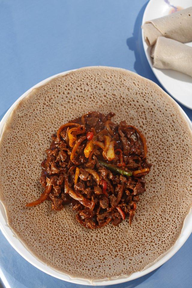 Derae Restaurant: Ethiopian fermented flatbread, called injera, cradles tibs, a spicy stew.