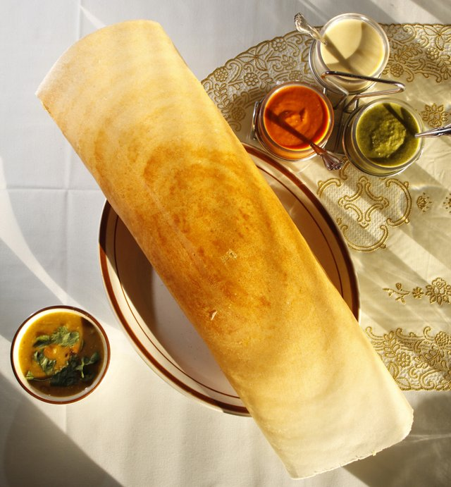 Mayuri Indian Cuisine: For vegetable korma, chefs top white rice with vegetables and a curried coconut and yogurt sauce.